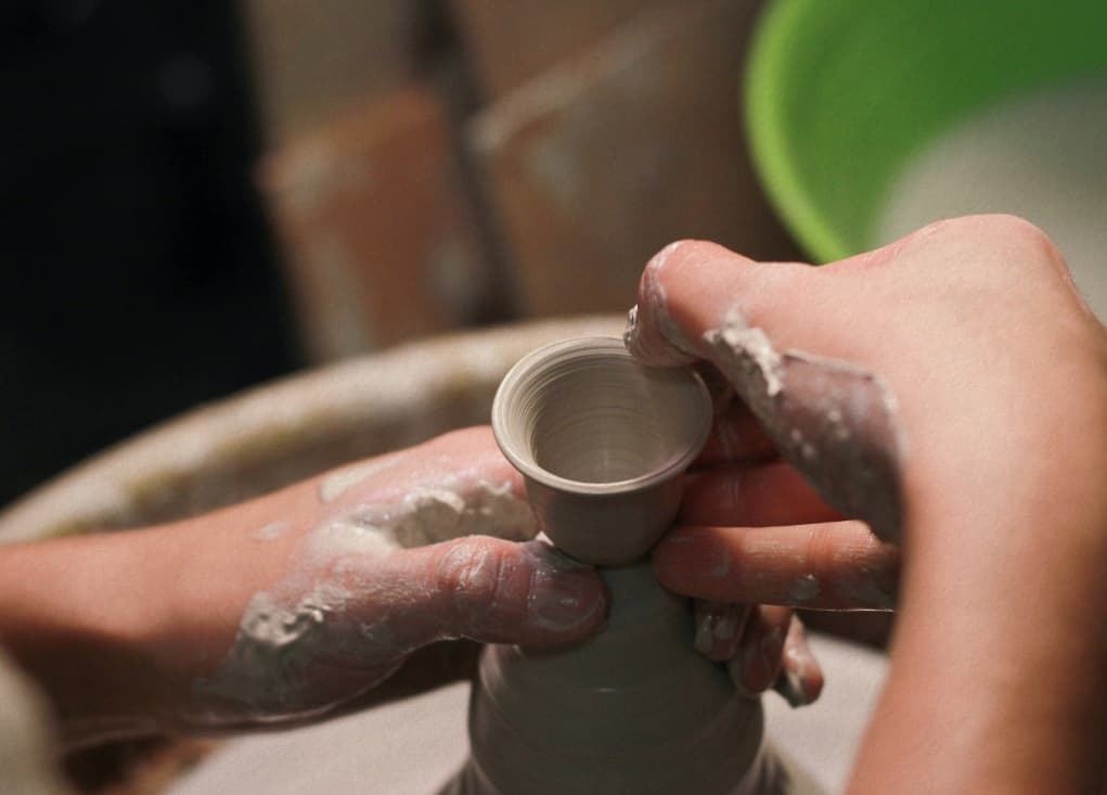 Pottery classes making an egg cup